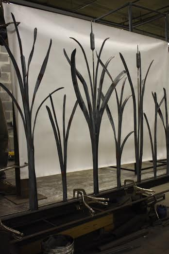 Cattail iron fence