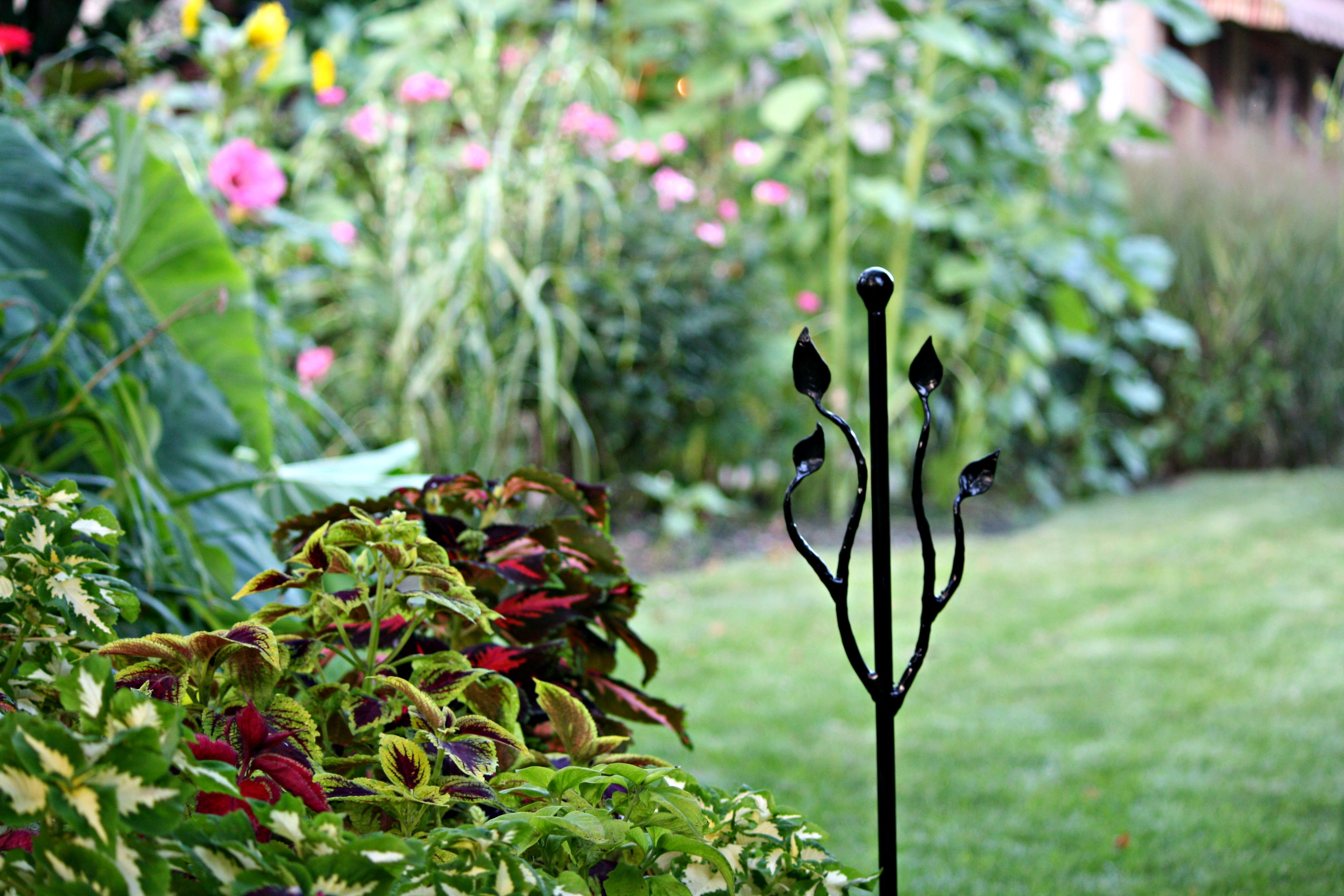 garden hose stakes. these unique garden stakes designed to guide a hose safely around plants