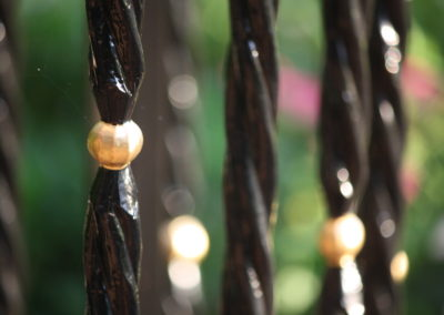 Gold Accents on Wrought Iron Railing