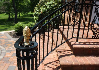 Curved Porch Railing with Gold Leaf Finials