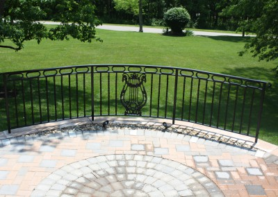 Curved railing with antique casting