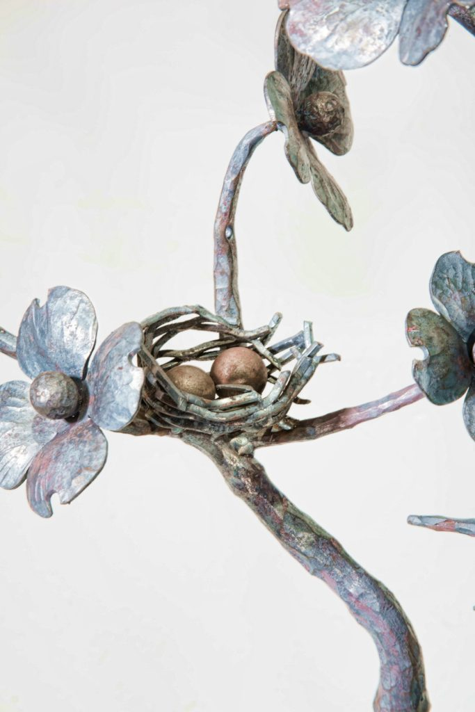 Metal Bird nest and flowers by Antietam Iron Works
