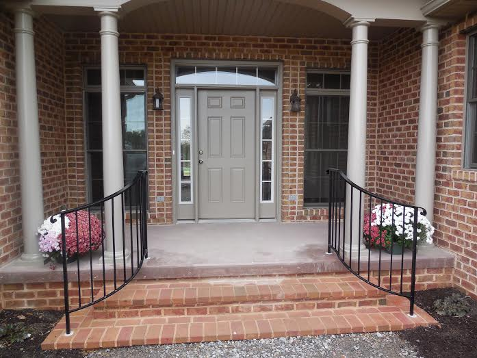 Curved Front Step Railing With Hand Forged Rail Cap Ends
