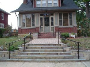 American Craftsman style home with a curved exterior step railing with Post and Cap and scrolls